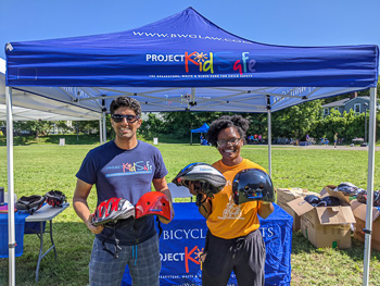 Attorney Reza Breakstone at bicycle helmet donation event in Mattapan.