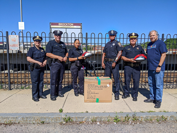 Brockton Police Department receives donation of children's bicycle helmets from Boston law firm of Breakstone, White & Gluck