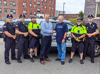Attorney David W. White gathers with members of the Lynn Police Department.