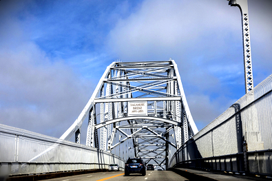 Car driving over Sagamore Bridge on Cape Cod, known for heavy traffic congestion and car accidents