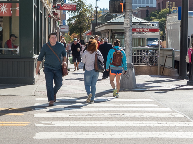 Pedestrians in a crosswalk on Massachusetts Avenue in Cambridge