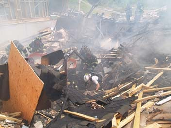 Firefighters responding to a fatal condo explosion in Norfolk, Massachusetts in 2010