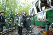 Firefighters after the MBTA Green Line crash in Newton in May 2008