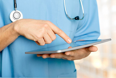 Boston nursing home staff typing incorrect patient data on a digital tablet