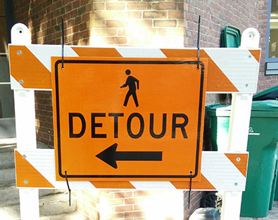 Pedestrian detour signs should be posted to avoid pedestrian injuries on construction sites.