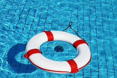 Swimming pool and a life preserver float