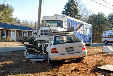 Pepsi truck crashes into a car in Massachusetts, causing damage and injury.