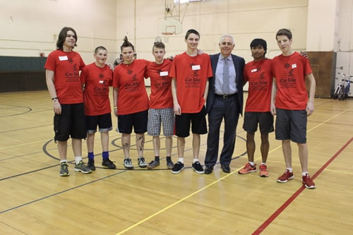 Attorney Ronald Gluck with volunteers at the iCan Shine bike camp inArlington.