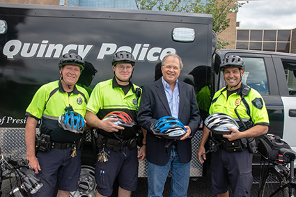 Boston attorney David W. White with members of the Quincy Police Department outside the Quincy Police Department headquarters in 2018.